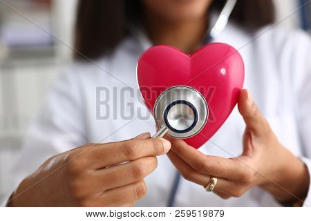 Beautiful Black Smiling Female Doctor Hold In Arms Red Toy Heart Closeup. Cardio Therapeutist Studen
