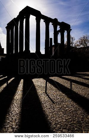 Evora, Portugal. Silhouette of the iconic Roman Temple dedicated to the Cult of the Emperor or Imperial Cult, wrongly considered as a Goddess Diana Temple for a long time poster