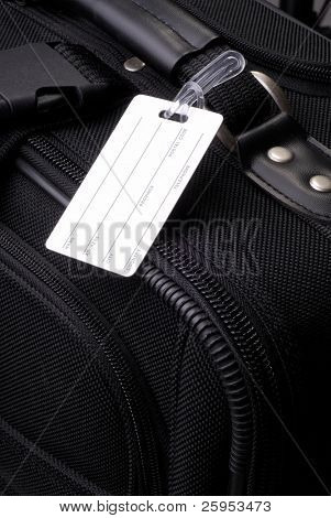 Blank Luggage Label On A Black Suitcase