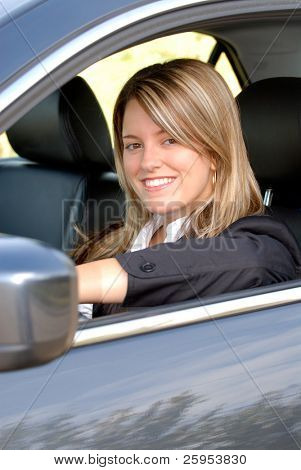 Happy Smiling Blond Businesswoman Driving Her Car