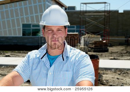 Young Attractive Male Construction Site Foreman, Checking The Blueprints