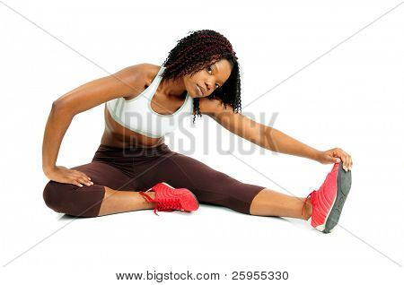 African American Woman Dressed For Fitness Stretching At The Gym Before Working Out