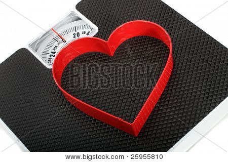 Bathroom Scales With A Red Heart Shaped Symbol For A Concept On Healthy Lifestyle