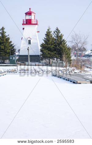 Lighthouse And Marina In The Snow