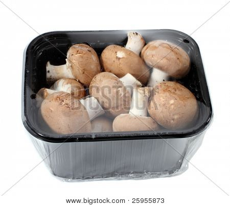 A Supermarket Package Of Fresh Cremini Mushrooms Isolated On A White Background