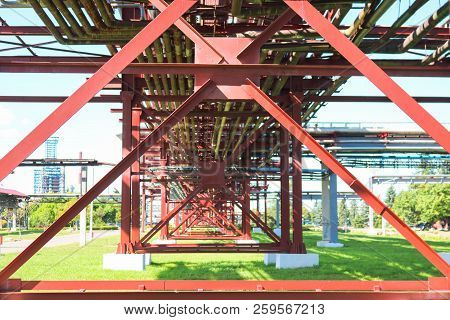 Red Metal Structures, Wheel Supports For Pipes, Pipeline Trestle From Large Beams, Piles And Stiffen