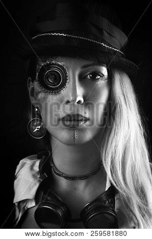 Steampunk Girl Portrait On Black. Monocular Lens