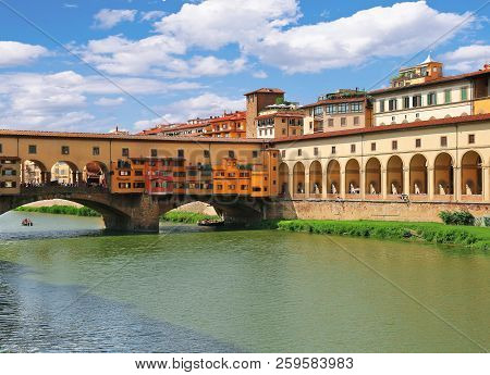 Ponte Vecchio Bridge And Arches Of Corridoio Vasariano (vasari Corridor) Across Arno River In Floren