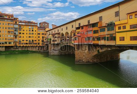 Close Up View With Architectural Details Of Ponte Vecchio Bridge Across Arno River In Florence (fire