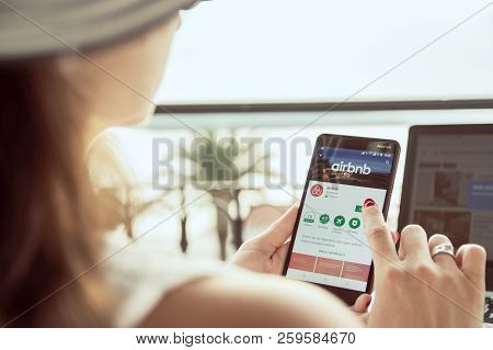 Trogir, Croatia  -  September 13th, 2018: Woman Is Installing Airbnb Application On Nokia Smartphone