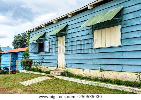 House Exterior With Blue Painted Clapboard Or Weatherboard Siding In Central America. Also Known As