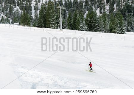 Minimal Style Winter Landscape With Ski Slope Full Of Snow, Surrounded By Snowy Fir Trees, And A Sin