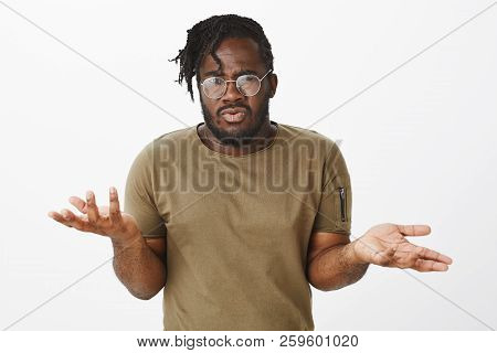 Guy Cannot Understand What Girlfriend Wants. Portrait Of Confused Displeased Dark-skinned Man In Cas