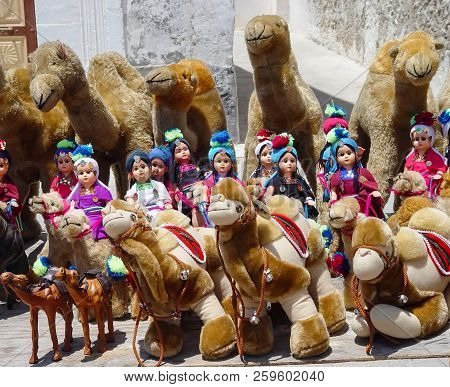 Puppet Riders In Turbans On A Plush Camel