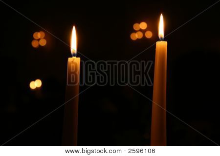 Two Candles Burning At Night