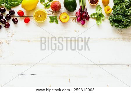 Flat Lay Of Seasonal Fruit, Vegetables And Greens. Summer Food Concept. Healthy Life And Vegetarian,