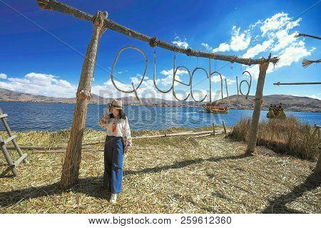 Lake Titicaca, Peru - August 17th, 2018: An Asian Female Takes Photos On Lake Titicaca, A Large, Dee