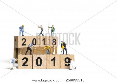 Miniature Worker Team Painting Number 2019 On White Background , Happy New Year 2019 Concept