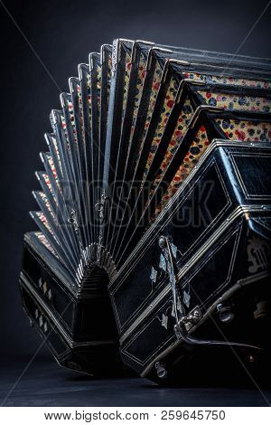 Close Up Of An Bandoneon Against A Black Background
