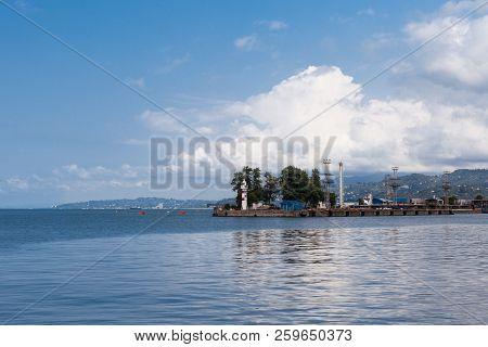 Batumi, Adjara, Georgia - August 29, 2018 Skyline View Of The Port Of Batumi With Lighthouse And Clo