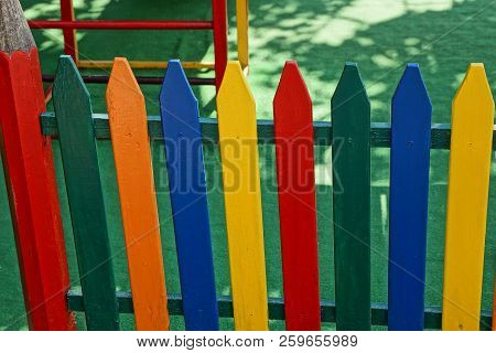 Colored Decorative Fence From Boards At A Children Playground