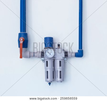 A Modern Filter With A Water Gauge For Cleaning From Debris And Heavy Metals, Located On The Wall, A