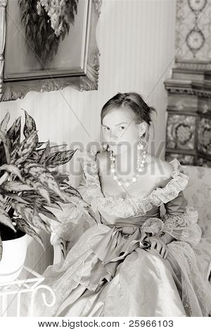 Girl with baroque style ancient dress, palnt and paintings