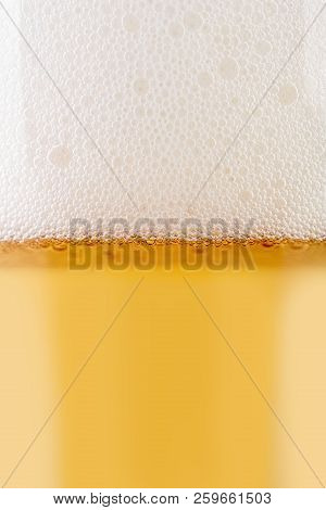 A Glass Of Light Beer On A White Background. Alcoholic Beverages