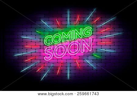 Coming Soon With Rays Neon Sign. Realistic Neon Effect On A Bric