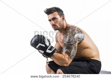 Shirtless And Muscular Man With Boxer's Gloves