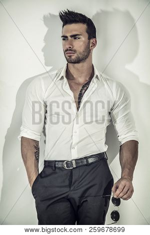 Elegant Attractive Man With White Shirt On White