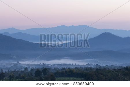 Sunrise In Northern Thailand With A Misty Landscape And Hills Seen From Yun Lai Viewpoint