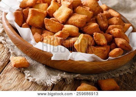 West African Popular Food: Appetizer Chin Chin Fried Crispy Dough Close-up In A Bowl. Horizontal