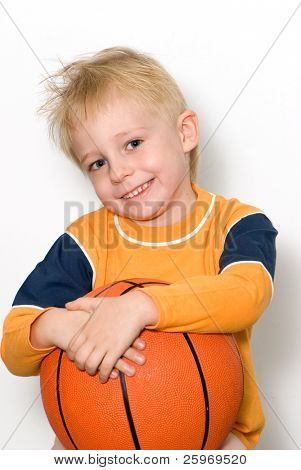 Portrait of the nice boy with a basketball ball