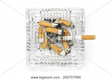 Glass Ashtray With Cigarettes Isolated On White, Top View