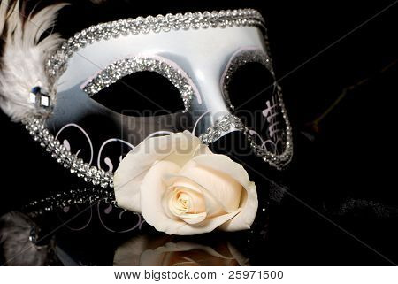 The Venetian mask and flower on a black background