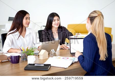 Group Of Businesswomen Working Together On Desk . Two Asian Worker Woman Send A Documents File To Bo