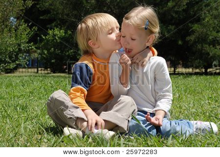 Emotional couple on a glade in park