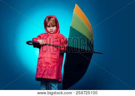 Child Advertise Your Product And Services. Cute Little Child Boy Wearing In Autumn Clothes On Autumn