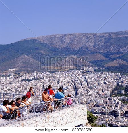 Athens, Greece - August 16,2015:  Tourists Looking At The City From Lycabettus Hill, Greece, Athens.