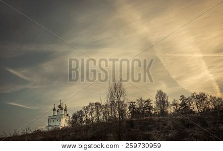 Dramatic Rural Countryside Scenery With Church On Hill And Dramatic Sunset Sky Copy Space