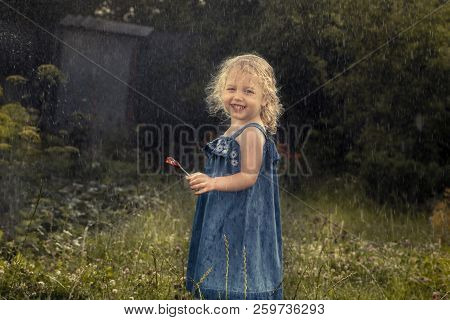 Happy Cheerful Child Girl Smiling Under Rain Countryside Concept Happy Carefree Childhood In Country