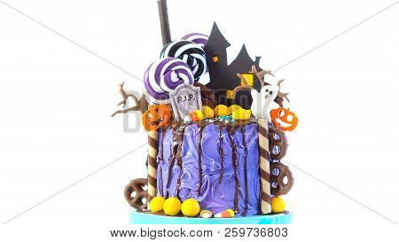 On Trend Halloween Candyland Novelty Drip Cake On White Background.