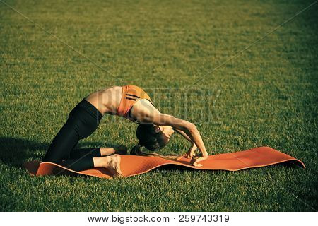 Active Woman Training On Green Grass, Activity Concept. Activity Outdoor, Energy, Fitness, Sport