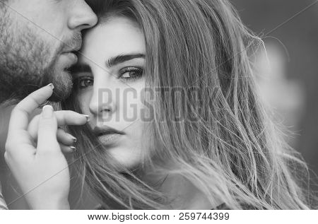 Male Lips With Unshaven Beard And Moustache Touching Adorable Face Of Pretty Girl Or Cute Woman With