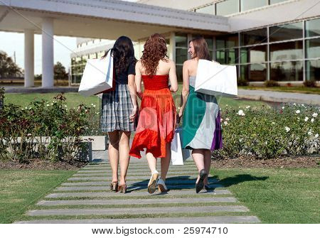 Clothes Shopping. Three girlfriends going with shopping bags
