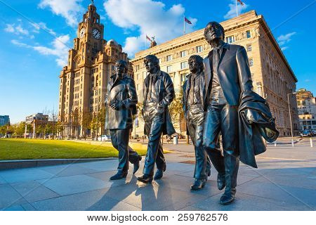 Liverpool, Uk - May 17 2018: Bronze Statue Of The  Beatles Stands At The Pier Head On The Side Of Ri