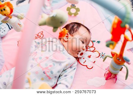 Cute Baby Girl On Colorful Gym, Playing With Hanging Toys At Home, Baby Activity And Play Center For