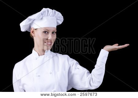 Smiling Female Chef Displaying Your Product Or Text
