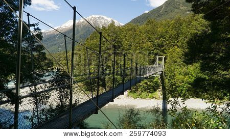 Suspension Bridge From Rope And Wood In Mount Aspiring National Park, New Zealand